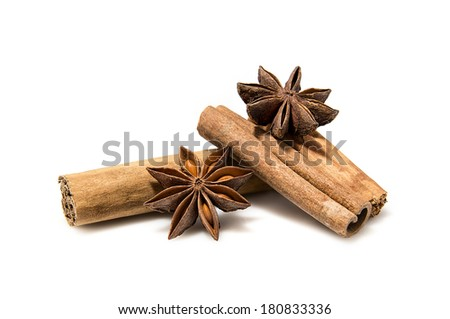Cinnamon sticks and anise stars on white background