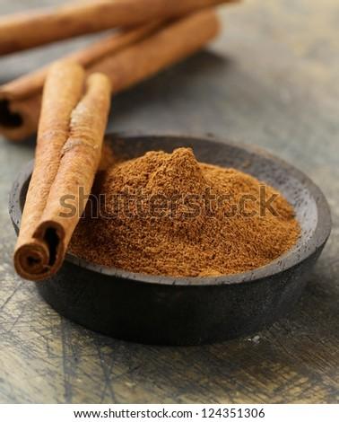 Cinnamon sticks and powder cinnamon - stock photo
