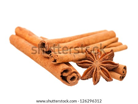 Cinnamon sticks and star anise isolated on white background - stock photo