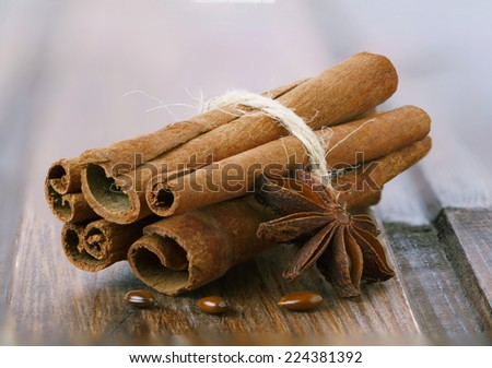 Cinnamon sticks and star anise on a wooden table - stock photo