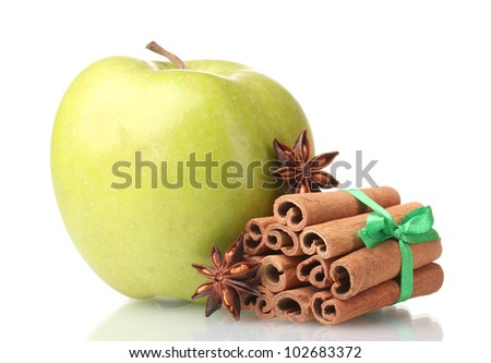 Cinnamon sticks, apple and anise isolated on white