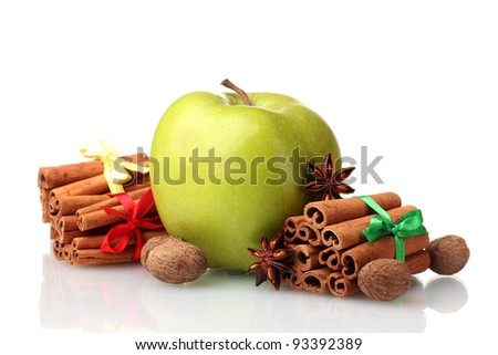 Cinnamon sticks, apple, nutmeg and anise isolated on white