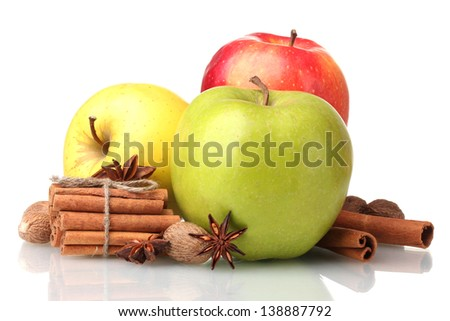 Cinnamon sticks, apples, nutmeg and anise isolated on white
