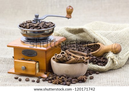cinnamon sticks, coffee beans and coffee grinder