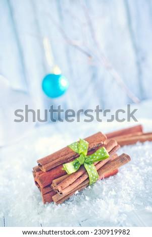 cinnamon sticks for christmas baking on a table - stock photo