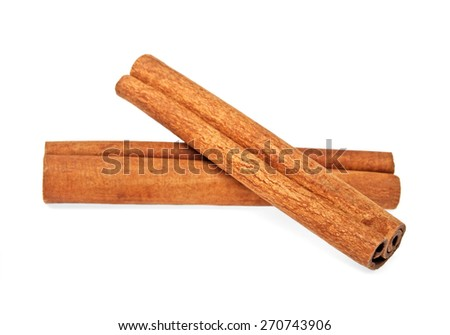 Cinnamon sticks isolated on a white background - stock photo