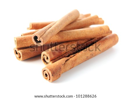 cinnamon sticks on a white background. - stock photo