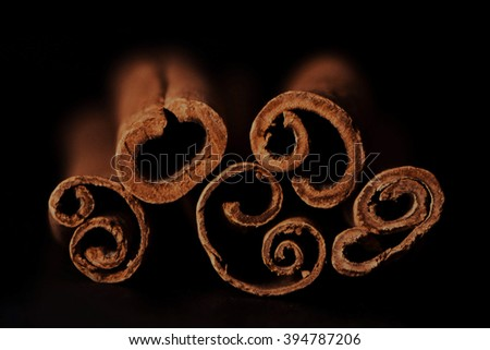 Cinnamon sticks on black background close up