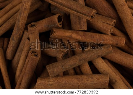 Cinnamon sticks spice closeup background. Texture of cinnamon sticks. Top view image