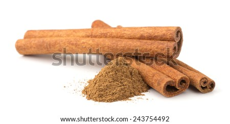 Cinnamon sticks with powder on white background - stock photo