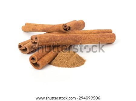 Cinnamon sticks with powder on white background - stock photo