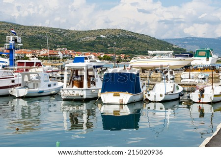 CIOVO, CROATIA - AUG 22, 2014: Boats on the Adriatic Sea near the coast of Ciovo, small Croatian Island. Ciovo is an island in the Adriatic Sea with area of 28.8 km2