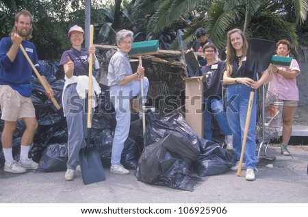 CIRCA 1990 - A group of community people clean up the river on Earth Day - stock photo