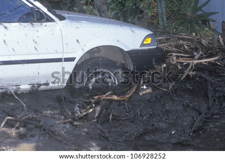 CIRCA 1994 � A small car stuck after the mudslides in Malibu, California