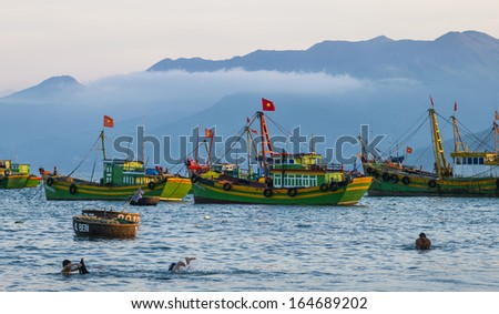 CIRCA APRIL 2010 - QUY NHON, VIETNAM - Fishing boats moored off the shore, on 25 April 2010, at Quy Nhon, Vietnam.