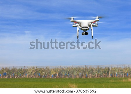 Circa, Circa - February 1, 2016: DJI Phantom 3 professional remote controlled drone equipped with high resolution video camera hovering in mid air
