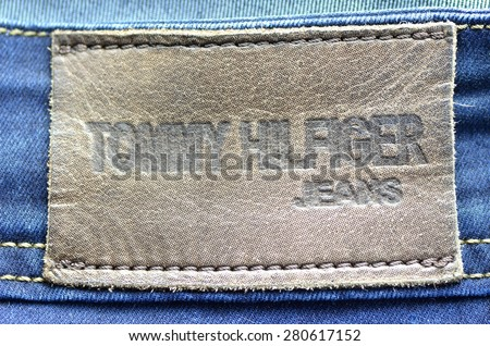 CIRCA JUNE 2014   KWIDZYN: Closeup of Tommy Hilfiger label on blue jeans. Tommy Hilfiger is lifestyle brand founded by American fashion designer Thomas Jacob Hilfiger (born in 1951).