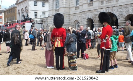 CIRCA JUNE 2012, LONDON,UK. British soldiers meet the public for photographs and signings following the Trooping of the Colour at Horseguards, celebrating the birthday of Queen Elizabeth  - stock photo