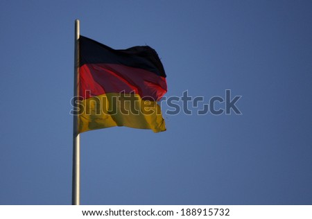 CIRCA OCTOBER 2013 - BERLIN: the German flag on top of the Reichstags building in Berlin.