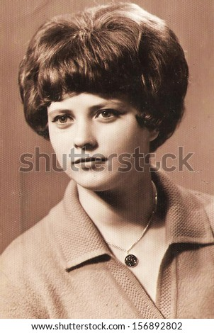 CIRCA 1965: Ordinary photo of an unknown young woman - Note: slight blurriness, better at smaller sizes - circa 1965  - stock photo