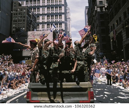 CIRCA 1991 - This is a Ticker Tape Parade commemorating the Desert Storm Victory Parade. It is located in the Canyon of Heroes. Around 4.7 million people attended. - stock photo