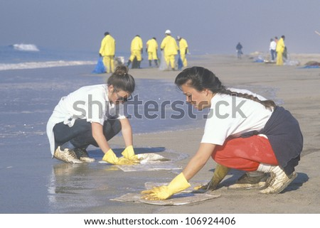 CIRCA 1990 - Two women participating in an environmental clean up in Huntington Beach, California - stock photo
