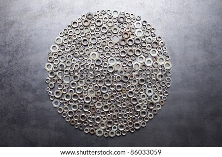 Circle from nuts on metal texture background - stock photo
