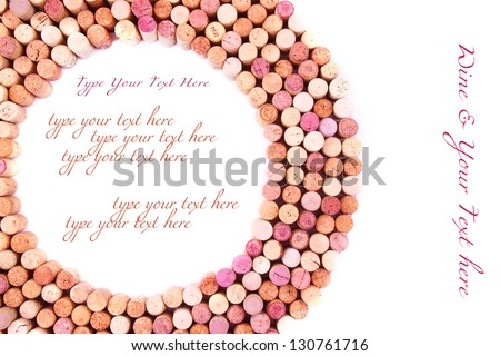 Circle made of wine corks on white background with empty space for text. - stock photo
