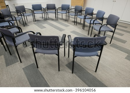 Circle of chairs in room for workshop and advanced education