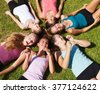 Circle of closed eyes teenage girls - stock photo