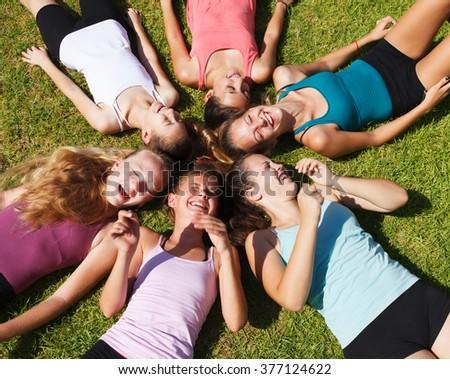 Circle of closed eyes teenage girls - stock photo