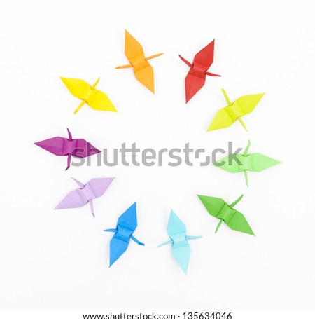 Circle of colorful origami paper cranes on a white background - stock photo