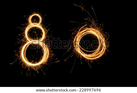 Circle of fire over black background. New year 2015. - stock photo