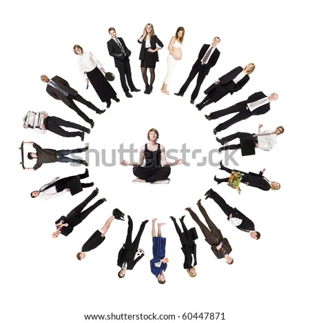 Circle of real people with a man meditating in the middle - stock photo