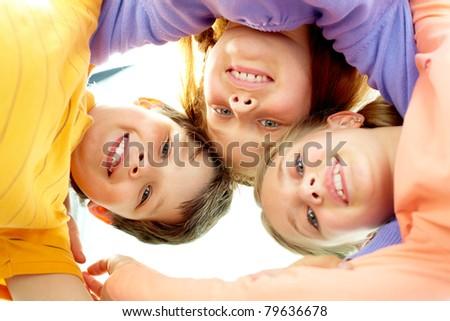 Circle of smart friends looking at camera - stock photo
