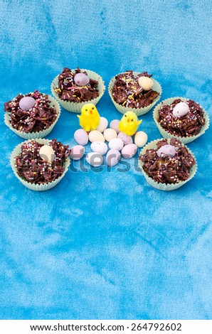 Circle of tasty Easter treats. Vertical. Copy Space. - stock photo