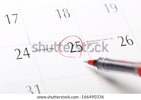Circled 25 on calendar; focus on date 25 - stock photo