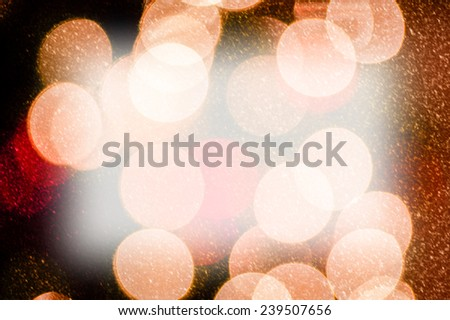 Circles of lights are blurred creating a bokeh effect suitable for any design. This texture has a snow effect adding to the image. - stock photo