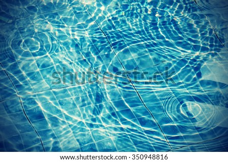 Circles on the water. Water ripples.stains on water. Gray and blue. - stock photo