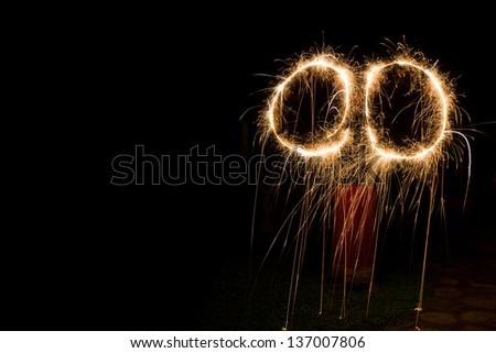 Circles using  Moving sparklers, a type of hand-held firework - stock photo