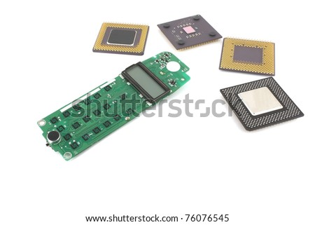 Circuit board (keypad) for cell phone with processors over white.