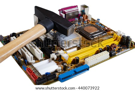 Circuit board of computer components and hammer - stock photo
