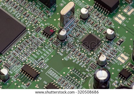 Circuit board with electronic components. Computer and networking communication technology concept. - stock photo