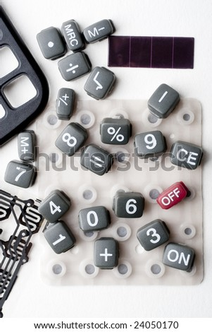 Circuit framework and keys of a calculator disarmed on white background