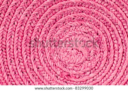 Circular background from pink rattan fibers. - stock photo