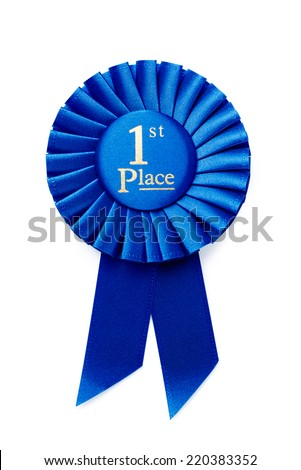 Circular pleated blue ribbon winners rosette with central text - 1st Place - in gold, isolated on white - stock photo