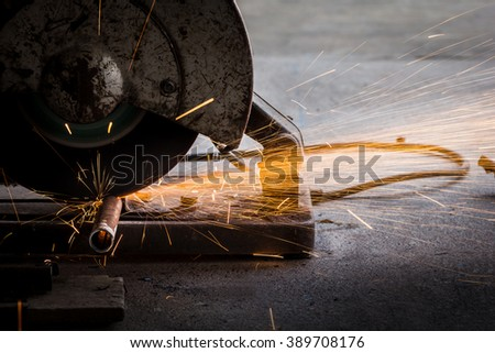 Circular saw cutting steel with split fire.