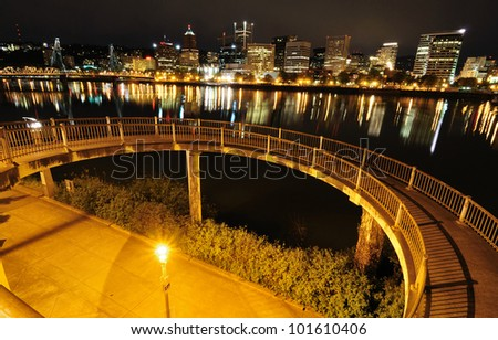 circular walkway and city view in night time - stock photo