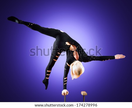 circus actor standing on the hand on a blue background - stock photo