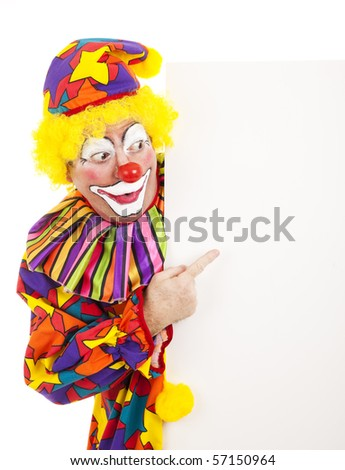 Circus clown pointing at a blank white space.  Isolated design element.